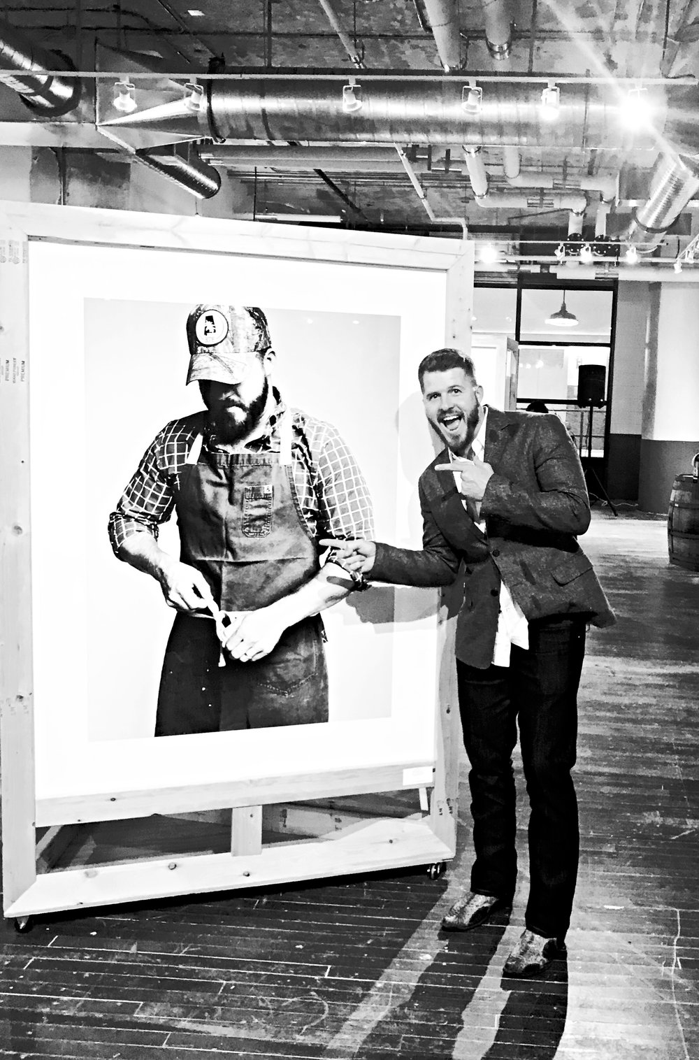Chef David Bancroft cheeses next to his finished portrait on opening night!