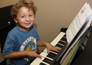 boy enjoying recreation music lesson with houston piano company.jpg