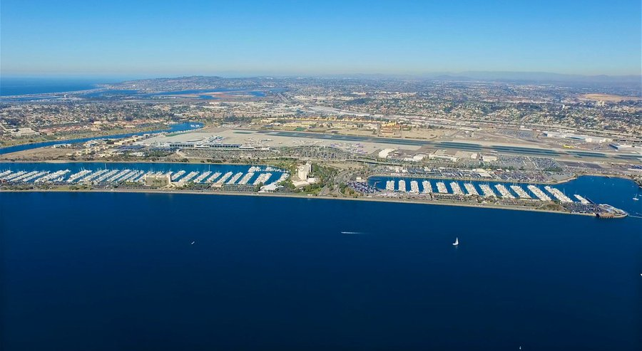 The 57 acres of land and water encompassing part of Harbor Island and the site of the rental car lots along Harbor Drive would be redeveloped under six bids submitted to the port district. San Diego Unified Port District