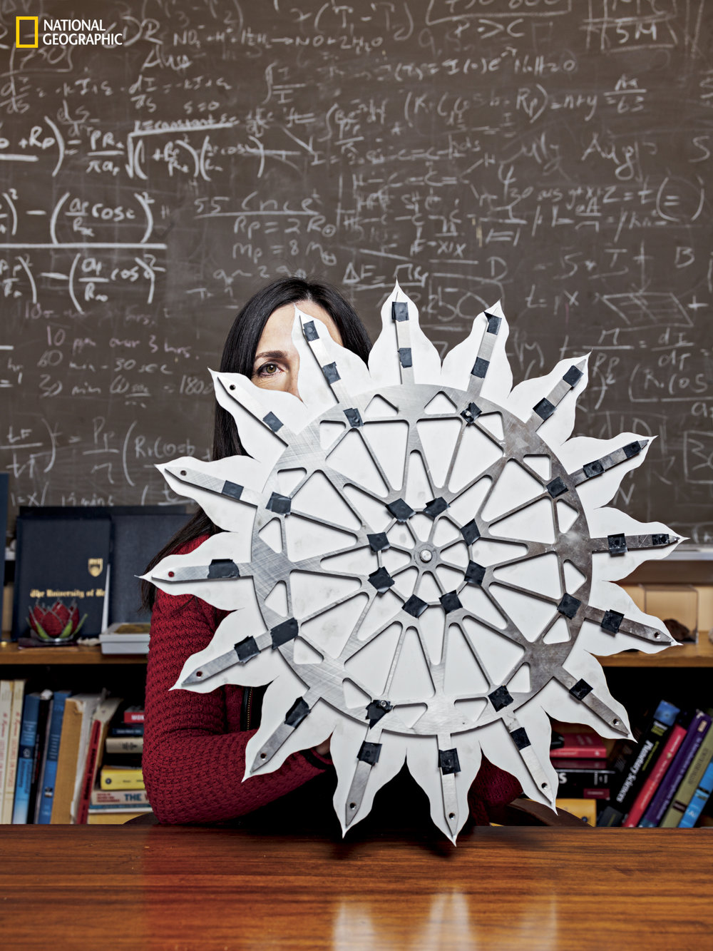 Dr. Seager explains how she and other astronomers are looking for extraterrestrial life. We discuss the Drake and Seager equations. We also talk about how astronomers might be able to detect life by measuring chemicals in distant planet atmospheres.    Image:  Using a model, MIT astrophysicist Sara Seager demonstrates Starshade, under development at NASA's Jet Propulsion Lab in Pasadena, California. Deployed in space, the device, more than 100 feet in diameter, would block the light from a star. A space telescope would capture an image of a planet when it's between Starshade's petals, seeking evidence that life may exist on the planet.  (PHOTOGRAPH BY SPENCER LOWELL / NATIONAL GEOGRAPHIC)