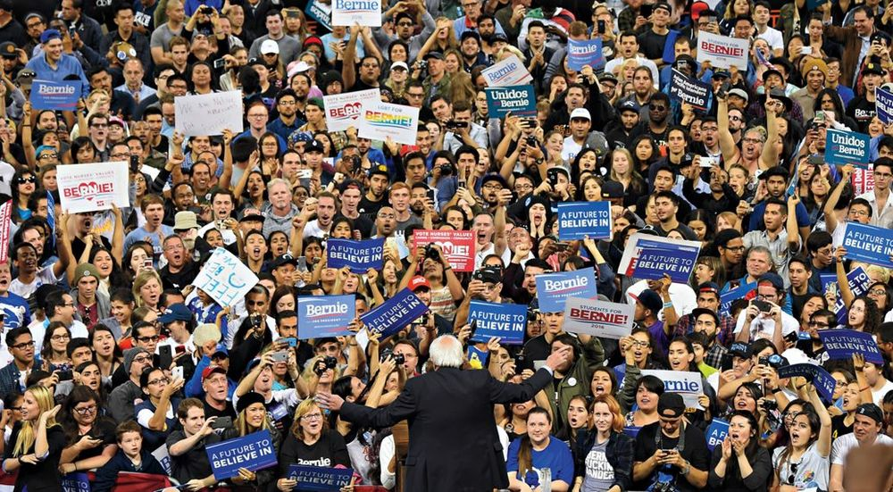 "Campaigning in Carson, California. ""When you look at the future of this country and the future of the Democratic Party, we are winning the overwhelming majority of people 45 years of age [and younger]. That's the political revolution."" - Robyn Beck/Getty via Rolling Stone"