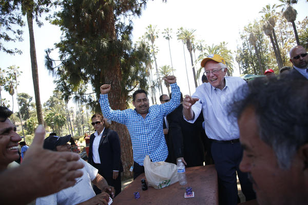 Bernie Sanders  and supporter Felix Garcia, left, at Echo Park Lake on Saturday. via Barbara Davidson /  Los Angeles Times