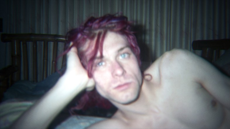 An unseen image of Kurt Cobain at home; via Universal UK