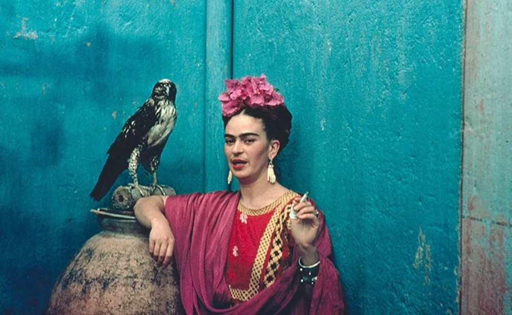 Frida Kahlo and her pet eagle; via Canadian Museum of Textiles and Dazed