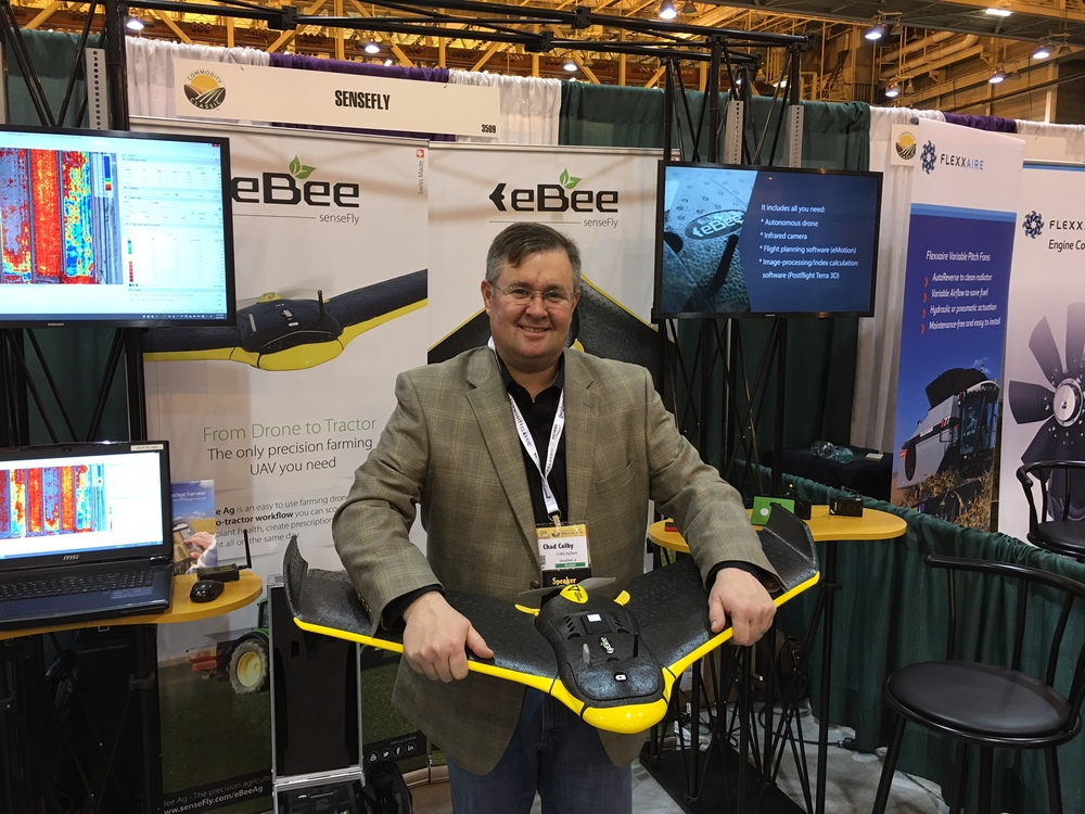 Holding eBee w/ integrated Parrot Sequoia sensor at 2016 Commodity Classic, March 2016.