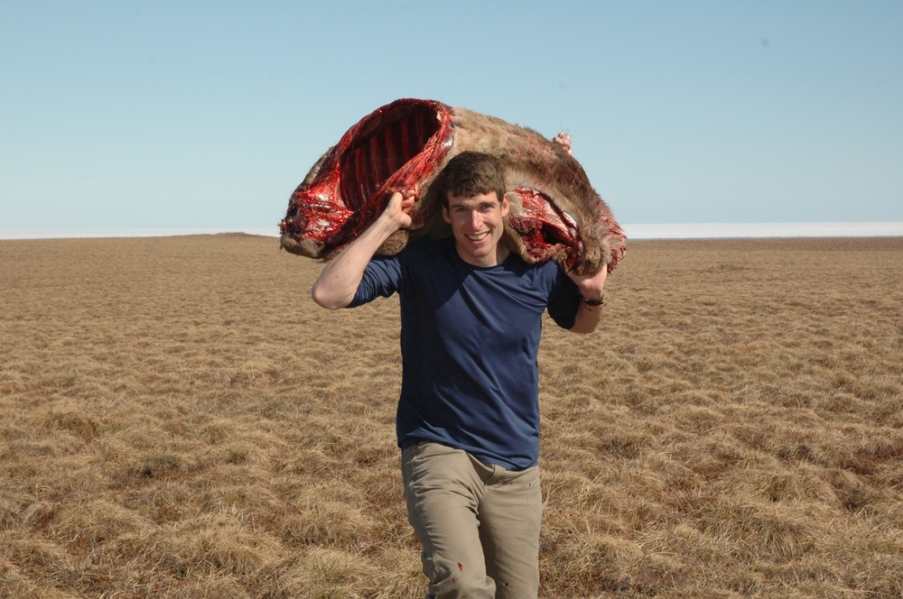 7. Andrew carries out caribou (1).jpg