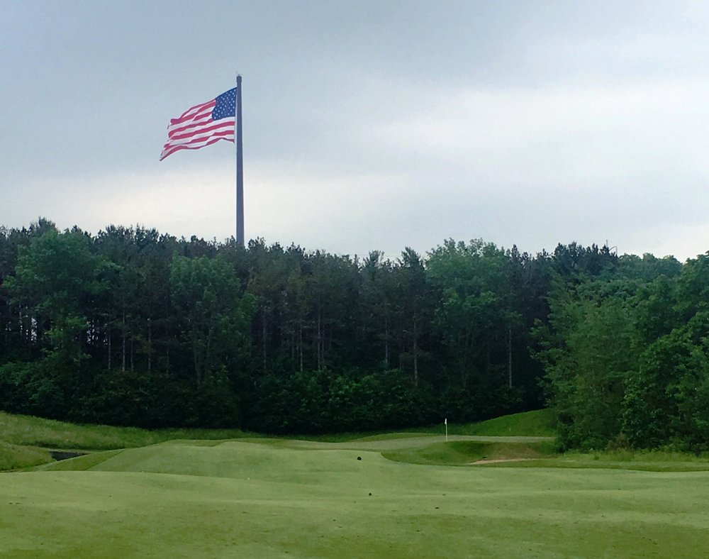 - The world's tallest flagpole flying the American flag, as seen from the River Course. Reaching 400 feet, it towers high above the treetops.