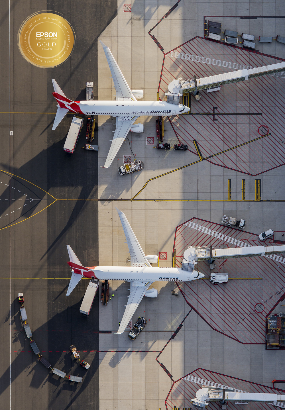 An aerial charter for Adelaide Airport at dusk to capture long shadows and depth around the airport precinct - I love the way the baggage train mimics the strong paint curves leading from the front of the two Qantas aircraft. This one really shows off the power combination of the Nikon D800 and 70-200mm VR2 lens that I usually use for aerial work, you can make out the rivets in the wings when you zoom right in! Processed in Lightroom and Photoshop.