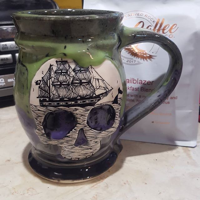 Like ships in the night . . . I walked out to ship a mug and @scrimshawpottery mug was on my front steps! I bet I won't get scurvy after drinking out of this mug!  #skull #late #mugshotmonday #pirates #ship #green #purple