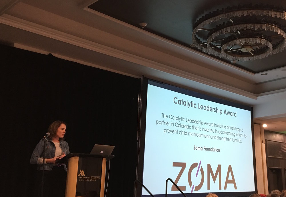 Tiffany perrin, senior program officer representing the zoma foundation, receives the catalytic leadership award on behalf of the foundation's investments in colorado.