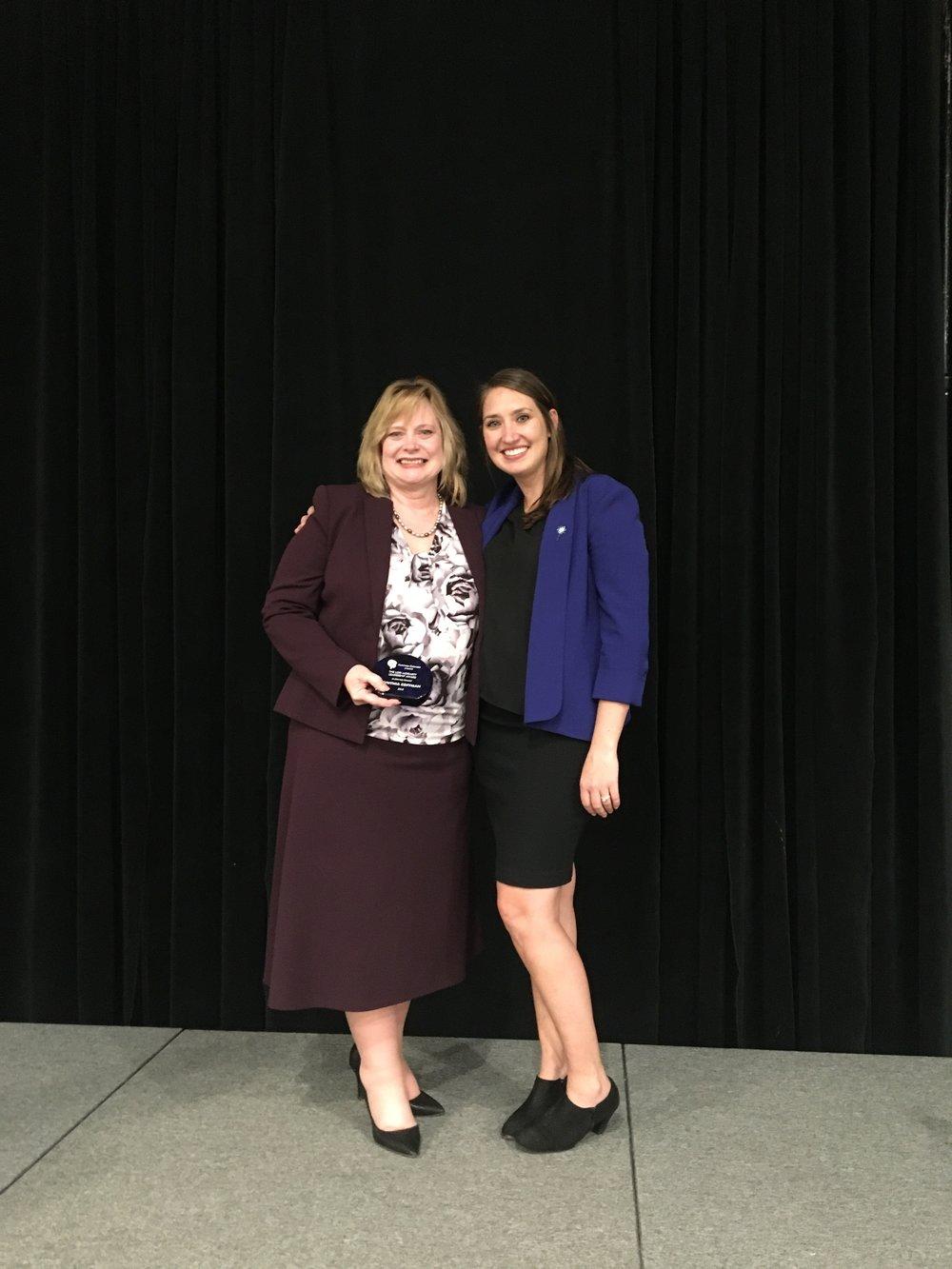 Awardee Attorney general cynthia coffman poses with Illuminate's executive director jade woodard.