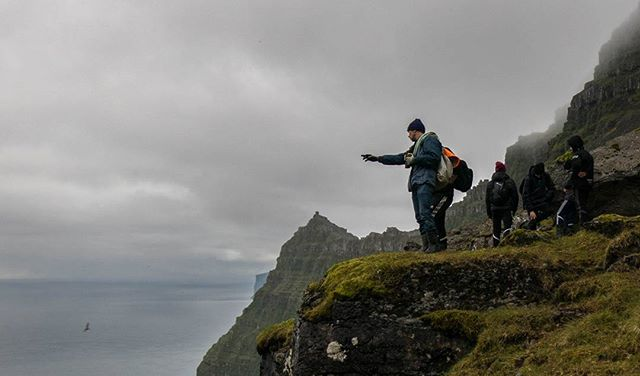Faroese shepherds use binoculars and two-way radios to spot for each other members of their flock that have scattered up the adjacent cliff faces over the summer months. Steeper cliffs have tend to have greener and more nutritious grasses fertilized by the droppings of nesting seabirds. Now just to get the sheep back down... #faroeislands #viðoy