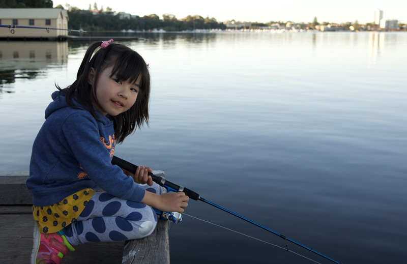 young-girl-fishing-on-jetty.jpg
