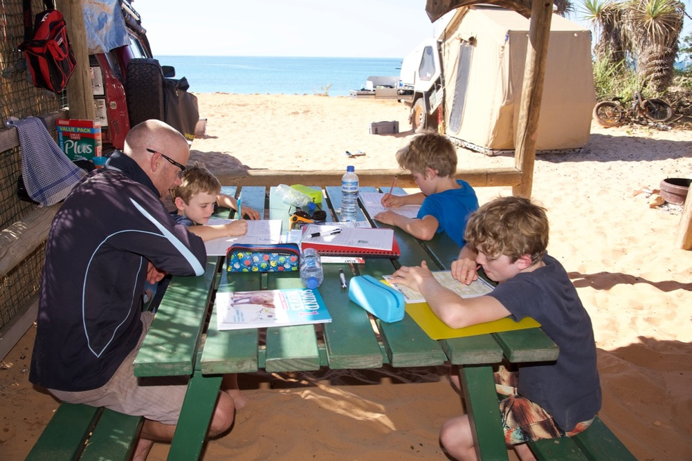 School work with kids at the beach