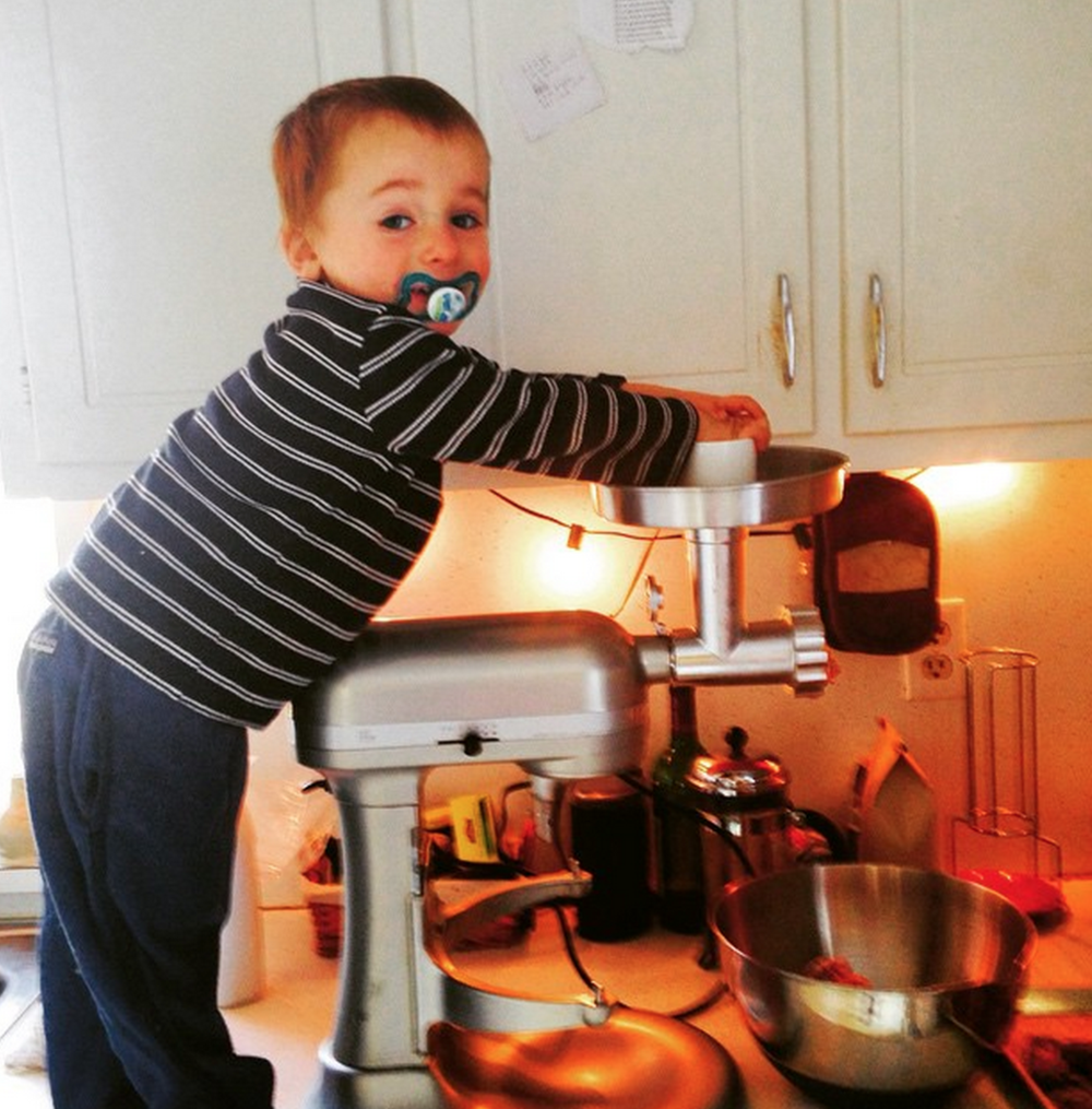 Tucker, 3, making sausage. Copyright Meredith Leigh