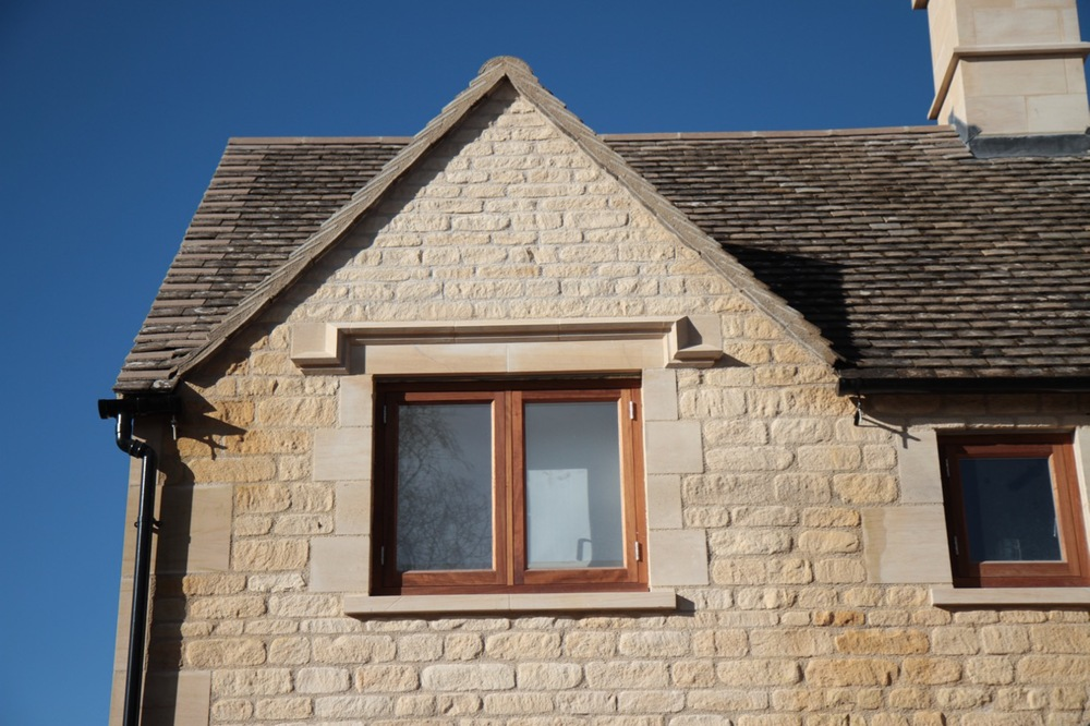 Bespoke hard wood window with stone sills, quoins, lintels & label moulds