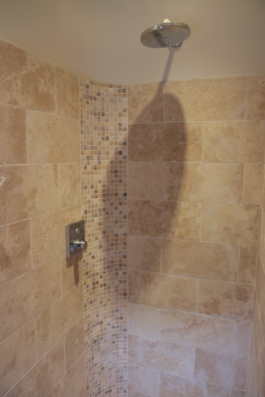 Wet room shower with limestone tiles