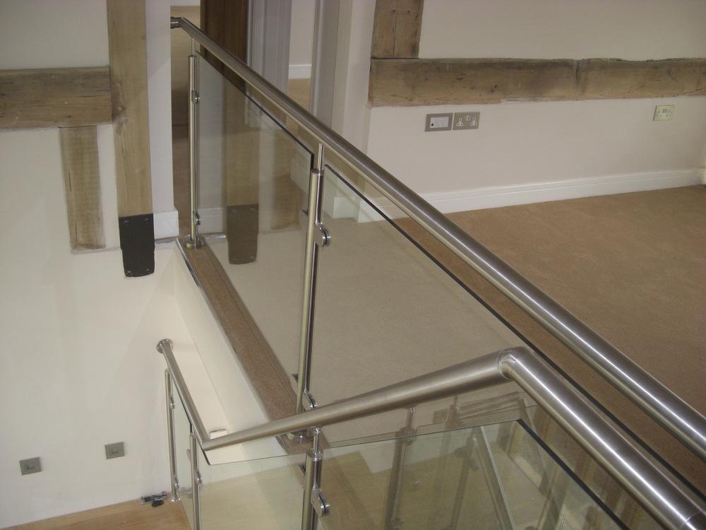 Bespoke glass and stainless steel balustrading