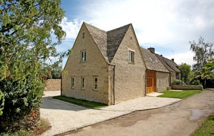 Finished barn conversion with swept stone roof valley