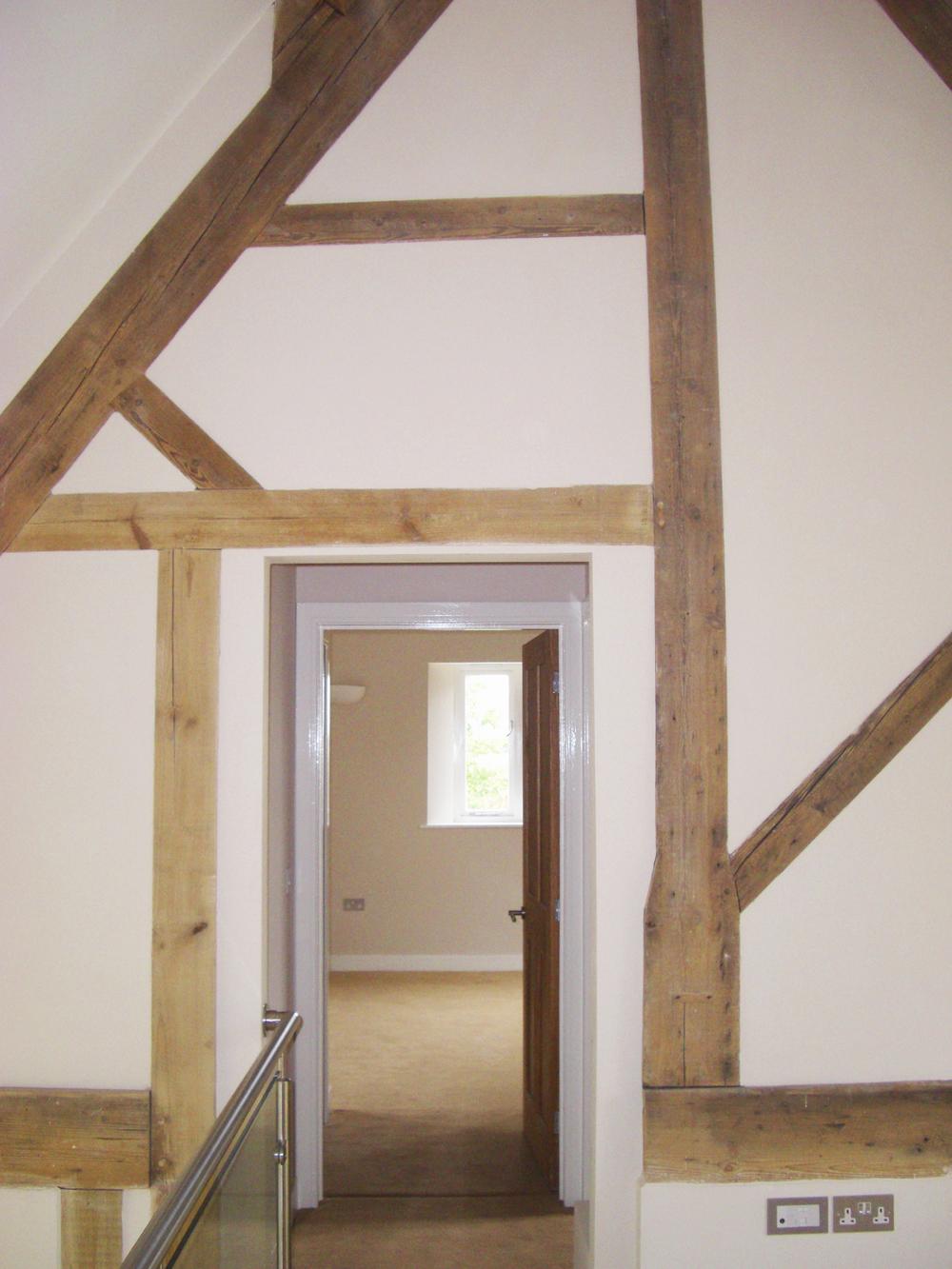 Reconfigured king post truss