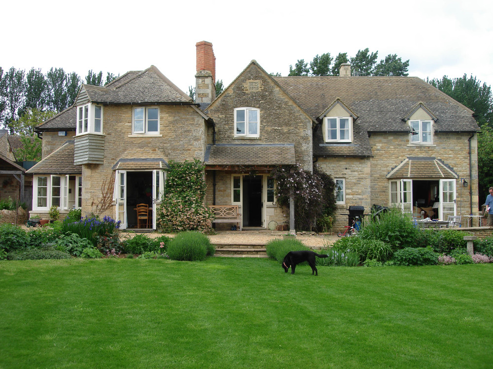 Conversion and restoration of Victorian cottages with new stone extensions and Rapunzel window