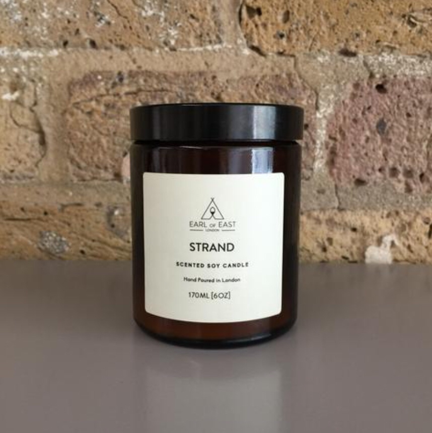 STRAND  Hand Poured in East London the Strand scented candle was inspired by a trip to Copenhagen. combined salty notes of seaweed with birchwood, bay leaf and mandarin rind to create a rich scent,  170ml [6 oz]  $30
