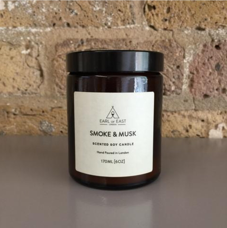 SMOKE AND MUSK  The Smoke and Musk candle is inspired by the great outdoors. Our unique blend green balsam fir sits alongside wood smoke and musky patchouli to create a sense of being in a cabin in the woods.  170ml [6 oz]  $30