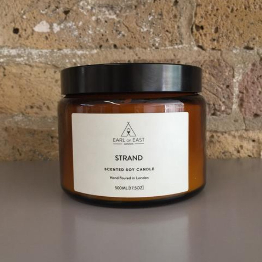 STRAND  Hand Poured in East London the Strand scented candle was inspired by a trip to Copenhagen. combined salty notes of seaweed with birchwood, bay leaf and mandarin rind to create a rich scent,  500ml [17.5 oz]  $70