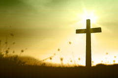 cross-sunset-silhouette-blurred-beautiful-golden-amazing-light-background-73337574.jpg