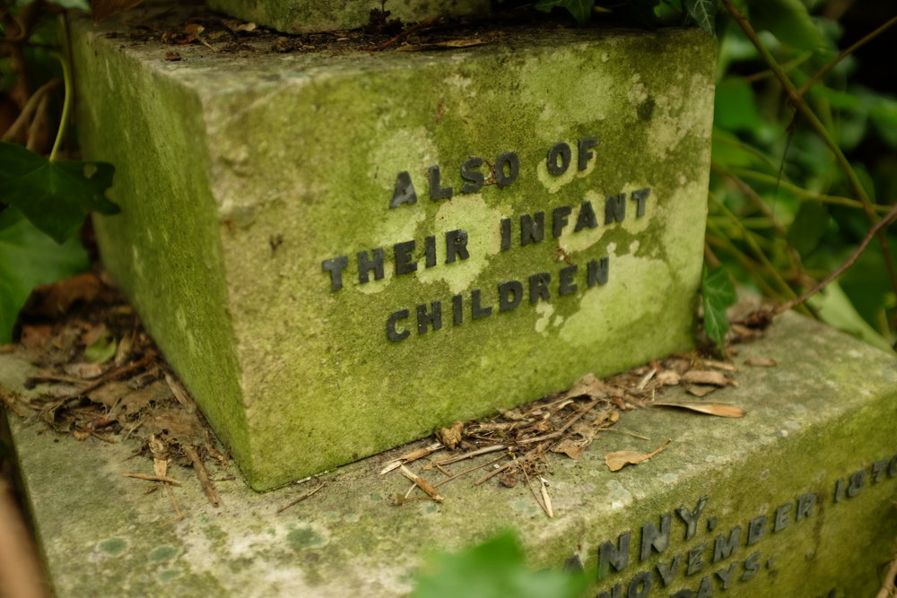 TALES OF ERAS PAST This grave at London's Highgate Cemetery paints a picture of a time when infant mortality was so high that families could not always inscribe the names all those they had lost.