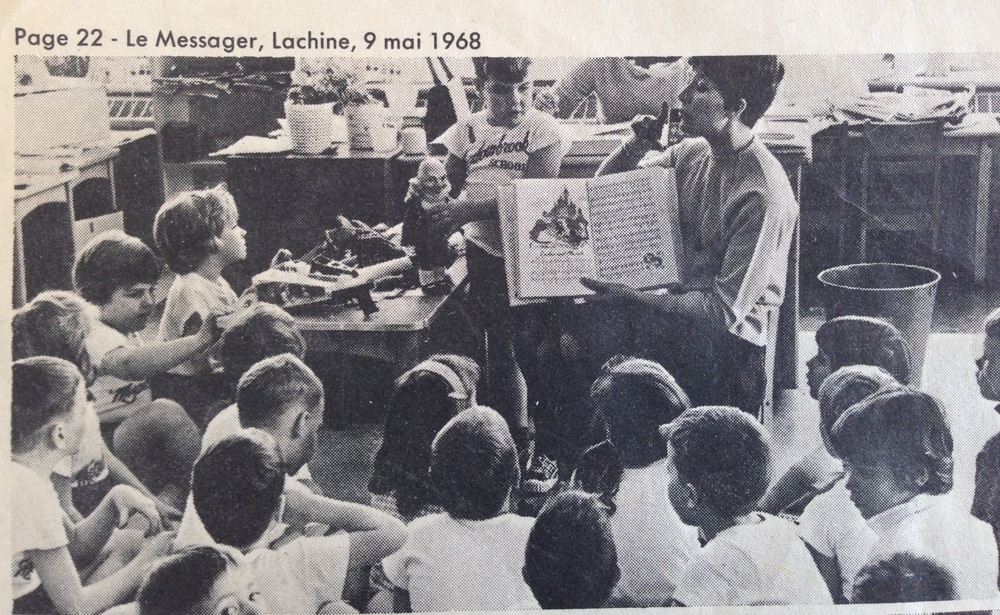 Mrs. Drummond reading a staged story for the benefit of the press, during show and tell.  That's me on the left, getting a closer look at Ricky's weird wizard doll that he brought in.  My toys were mostly cut outs of Bible characters stuck onto a flannel cloth, so seeing a somewhat pagan action figure was pretty exciting.