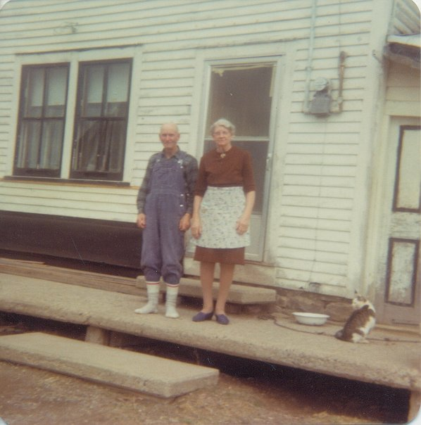My Great Uncle Archie and Grammy on the porch of the old homestead, watched by a ubiquitous cat. Rural New Brunswick Gothic at its best.