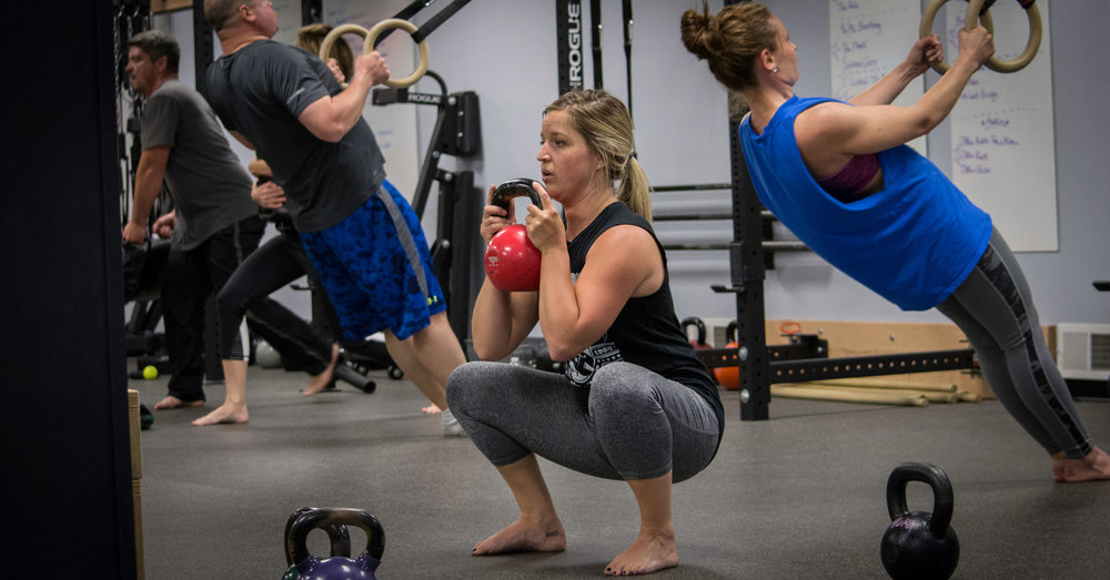 Shannon performing a goblet squat.  This drill is a great place to start when learning to squat with added weight.
