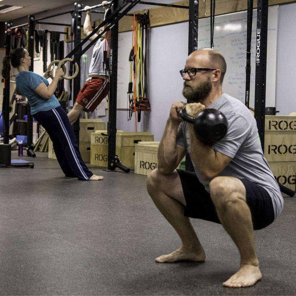 Joe S goblet sakb front squat row pull-up background facebook ad_Fotor.jpg