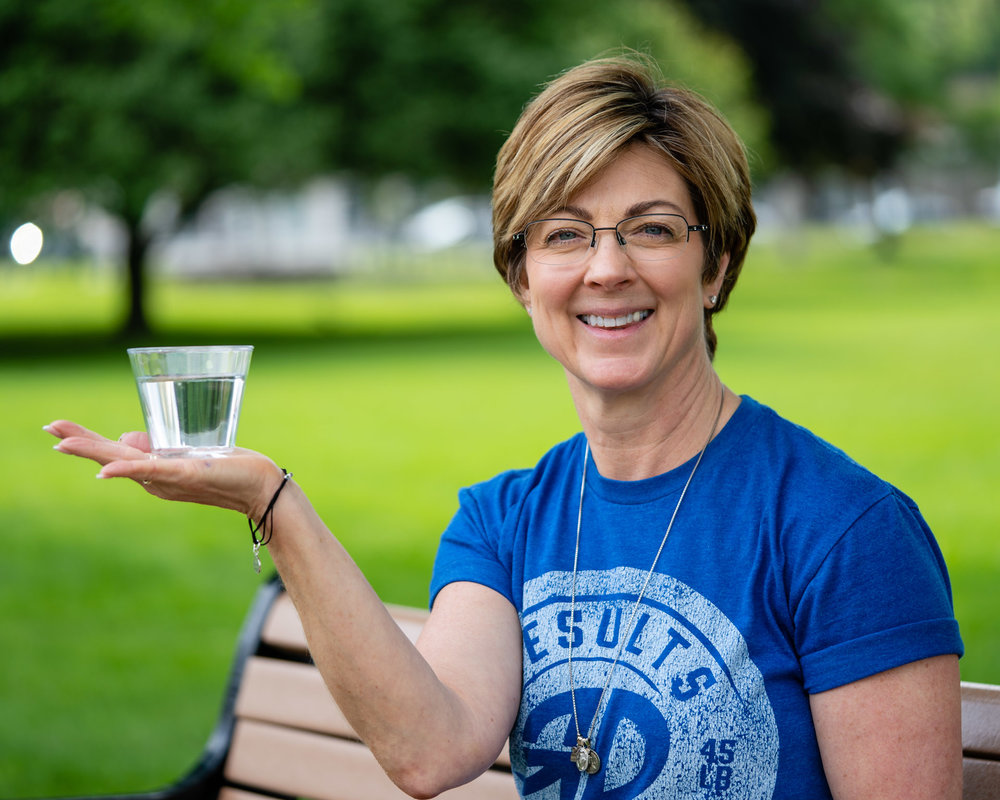 blog - cover photo - nutrition - nutrition level 1 - theresa holding cup of water 5x4.jpg