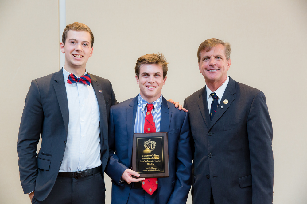 President Trevor Dowds (center) and Vice President Robert Purviance (left) with the award for highest chapter GPA in the nation.