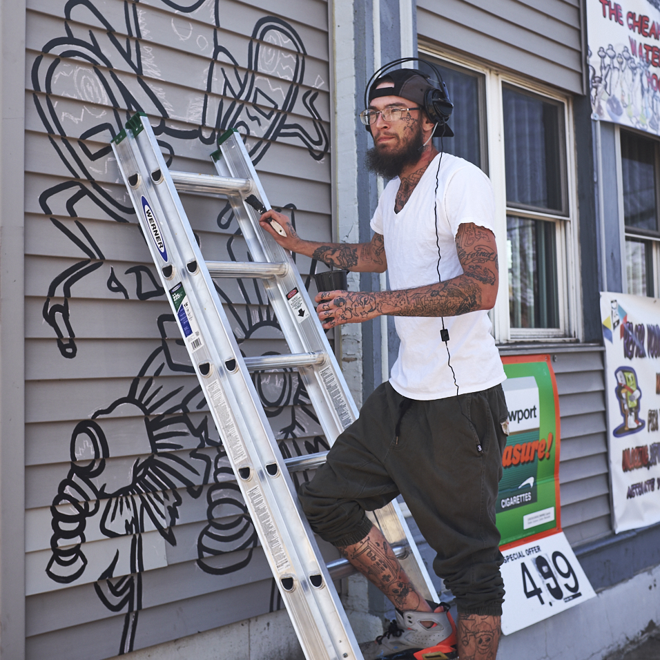 Painter Dustin Gravitt paints the outside of the Korner Konnection STL/Choo Choo Smoke Shop at 442 Bates St. Louis MO 63111 on Saturday April 8th,