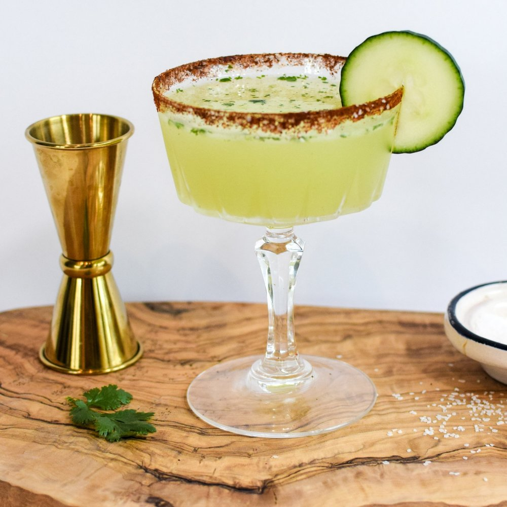 CUCUMBER MARGARITA - Ingredients:2oz. El Jimador Blanco Tequila1oz. Fresh Lime Juice1oz. Simple Syrup.75oz Triple Sec (or Grand Marnier)3 - 4 Slices of cucumber for muddling3-4 Slices of Jalapeno (optional)1 length-wise slice of cucumber for garnishingDirections:1. Add the 3 - 4 cucumber slices and jalapeno to your tin and muddle.2. Add tequila, lime juice, simple syrup and triple sec, dry shake for 15 seconds3. Before adding ice to your tin garnish your drinking glass by putting cucumber slice in glass and slowly adding ice as your wrap cucumber around the inside of glass4. Add ice to your tin, shake until chilled.  5. Strain and pour