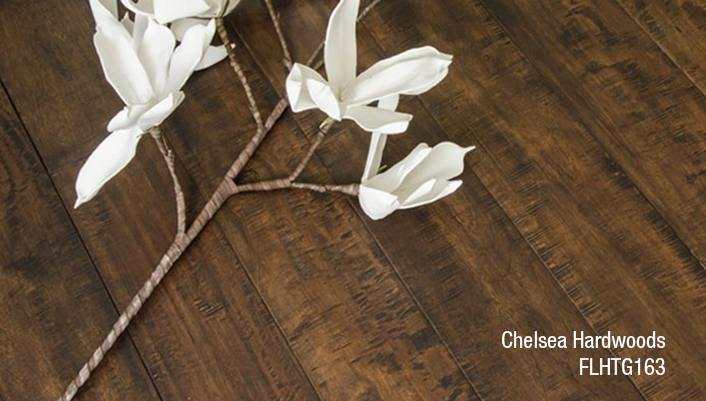 Reminiscent of timeworn factory flooring, Chelsea Hardwoods is a carefully hand-distressed, engineered plank. Available in four warm tones, the hardwood communicates a refined industrial quality.
