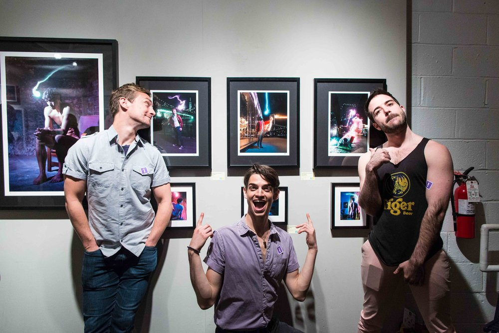 Brandon Haagenson, David Merten, and Joe Chisholm from  Afterglow  posing in front of their likenesses.