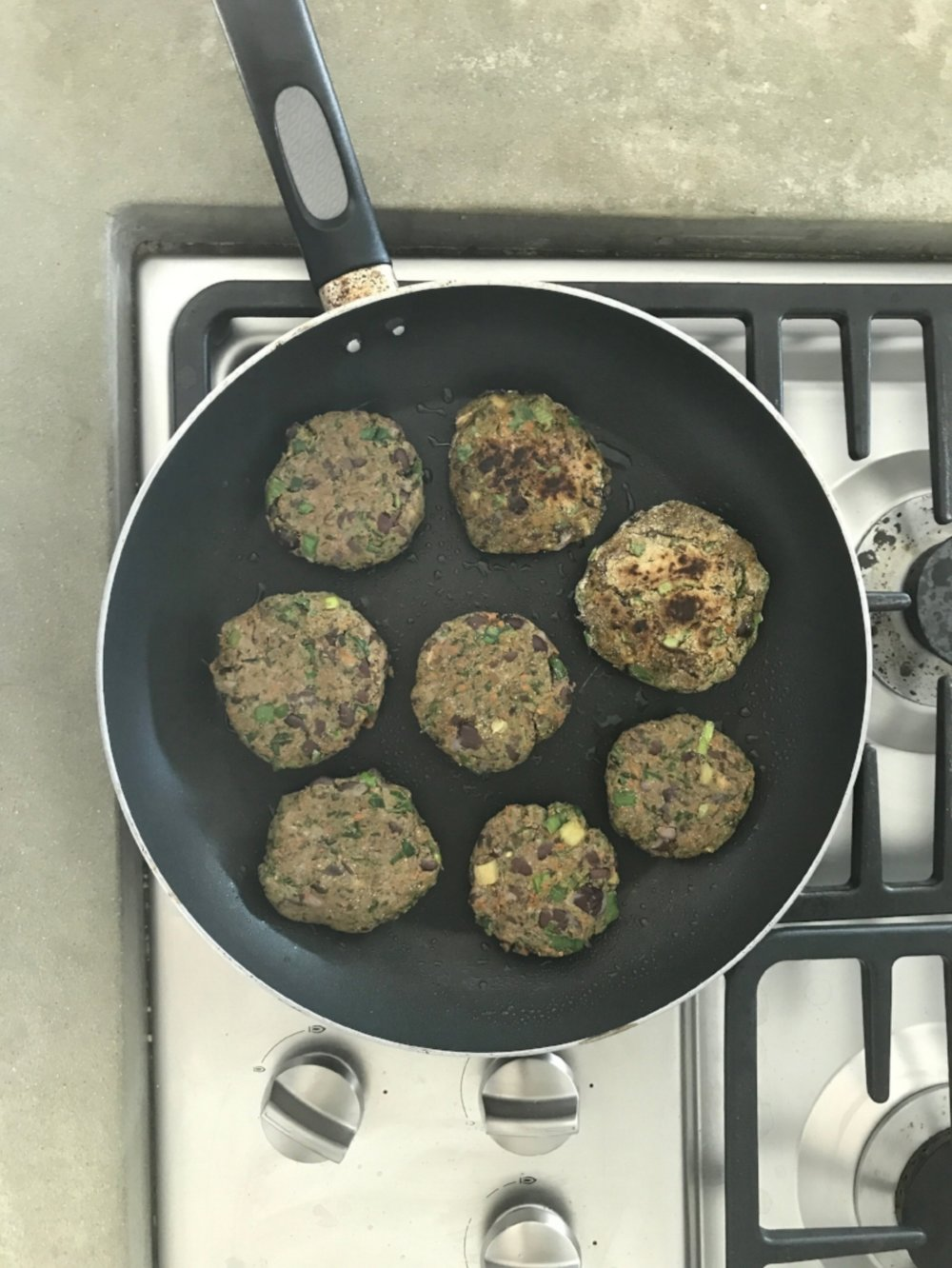 After combing all the ingredients in a food processor, we added the patties to a sizzling skillet.