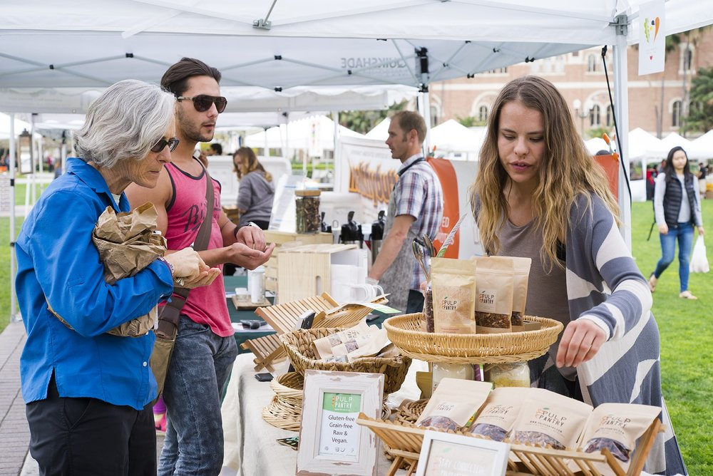 Kaitlin Mogentale, co-founder of Pulp Pantry with her Grain-Free, Paleo, Raw, Gluten-free, Organic, Local, Plant-based, dairy-free, refined-sugar free granola at a farmer's market