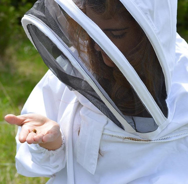 The beekeeper in her element.