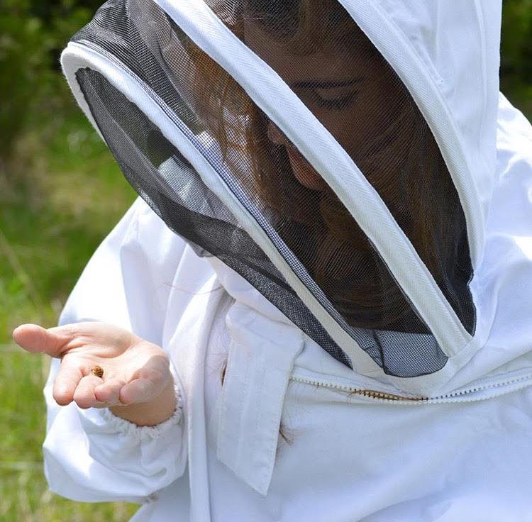The beekeeper in her element.