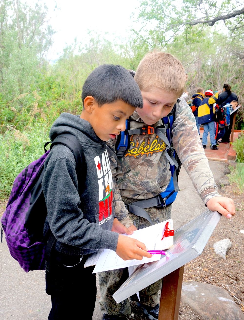 5th graders explore a local nature area learning about watershed science.