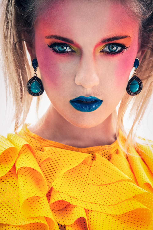 Female model wearing yellow Avant Garde swimwear and makeup
