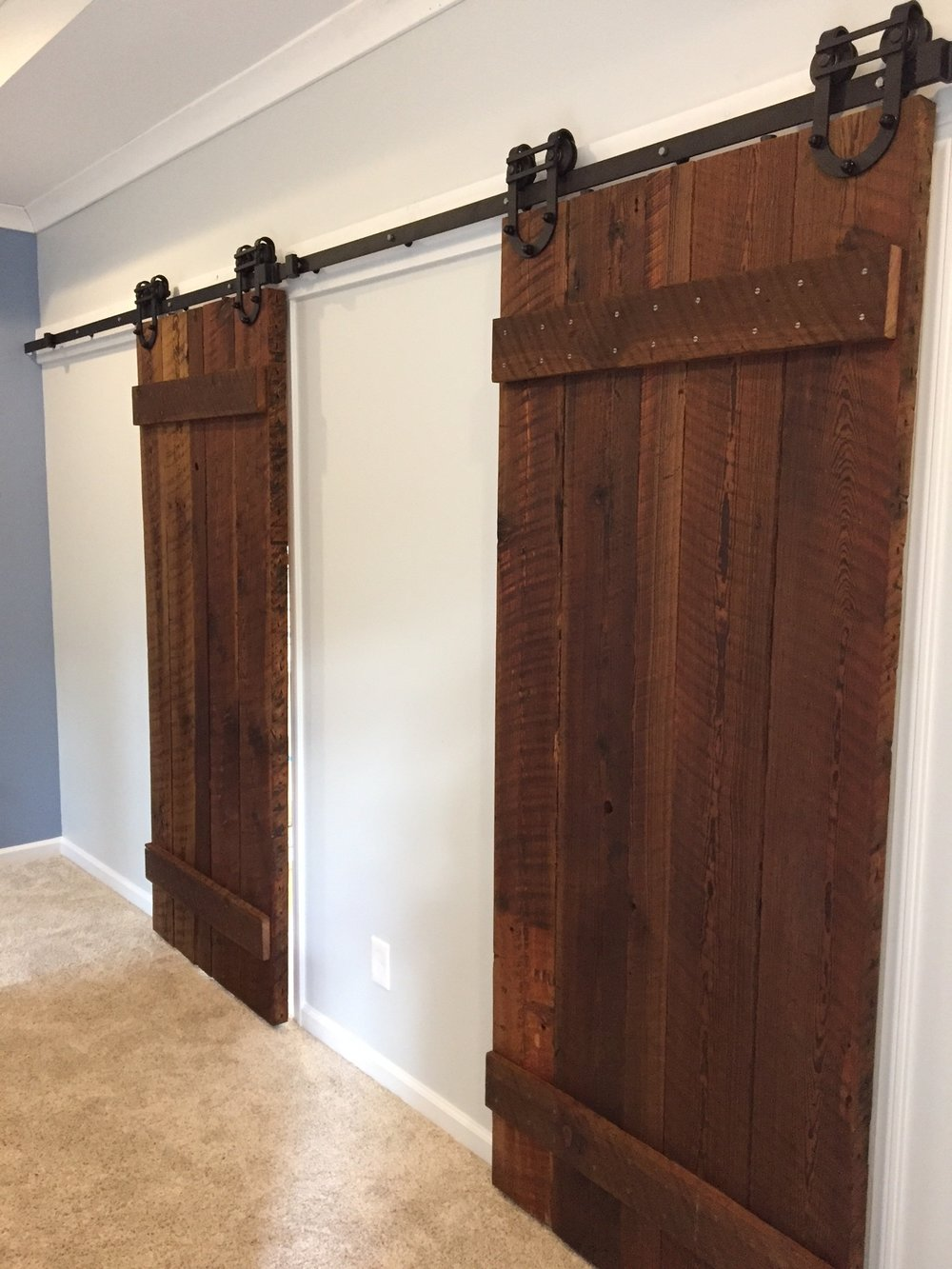 Bathroom & Closet doors covered by Georgia Tech Tower repurposed lumber.