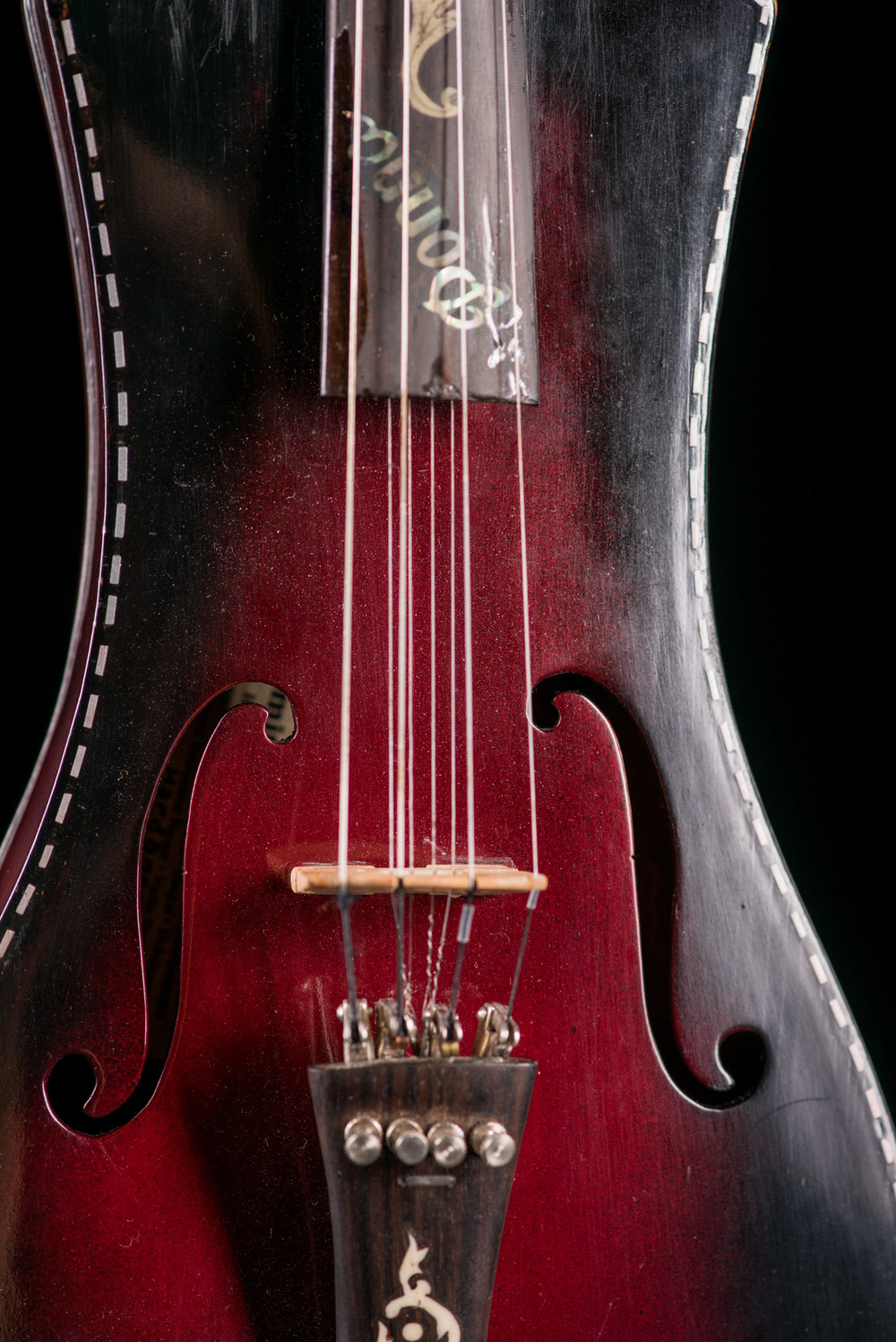 An 8-string fiddle with a lion's head carved where the scroll should be, a creation of 90 year old Elliot Smith from Jasper, Arkansas.