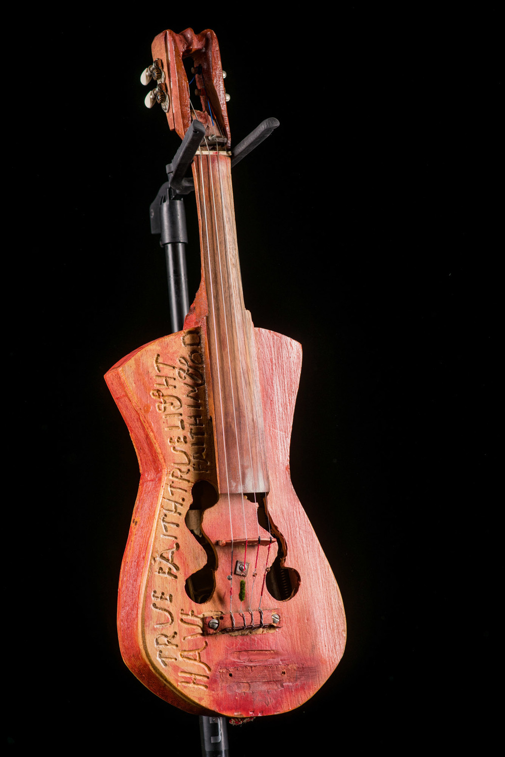 A fiddle & guitar made by legendary Ozark instrument builder Ed Stilley from Hog Scald Holler, complete with innards of springs and saw blades.