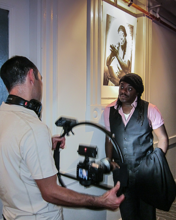Regie Gibson, slam poet, being filmed by John Neely, at GrubStreet